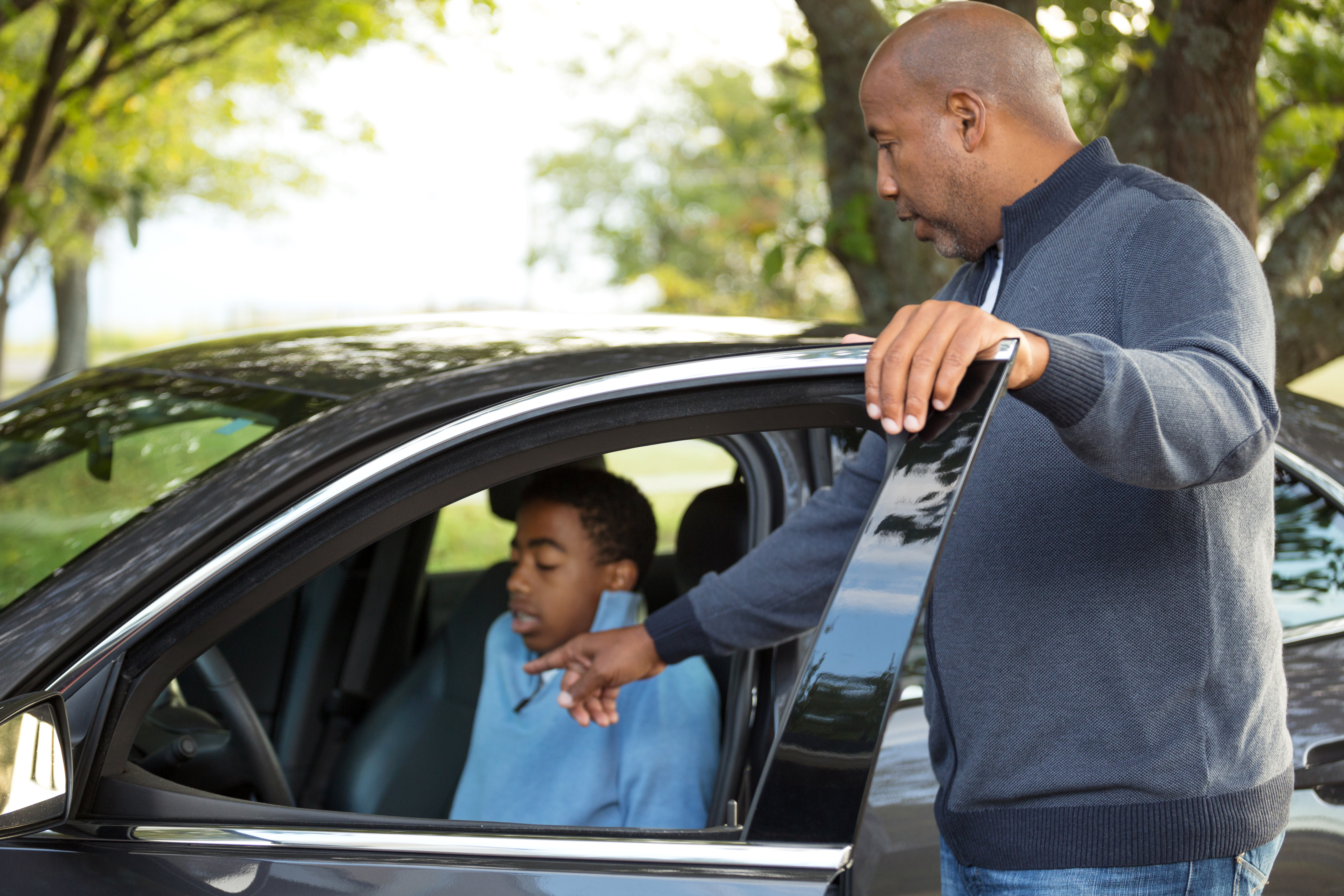 Male instructing teen driver